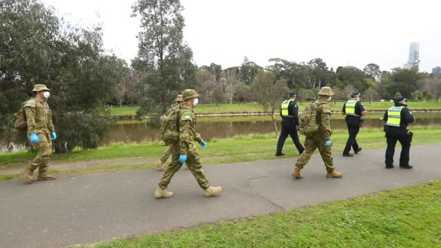 victoria police and the australian military patrol the banks of the yarra river on july 23, 2020 in melbourne, australia. face masks or face... - military stock videos & royalty-free footage