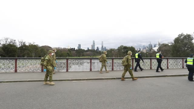 victoria police and the australian military patrol the banks of the yarra river on july 23, 2020 in melbourne, australia. face masks or face... - lockdown stock videos & royalty-free footage