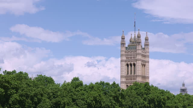 victoria tower alongside the river thames / london, england - cumulus stock videos & royalty-free footage