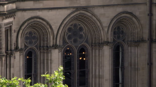 victorian arches and rose windows decorate the manchester town hall in england. available in hd. - rathaus stock-videos und b-roll-filmmaterial