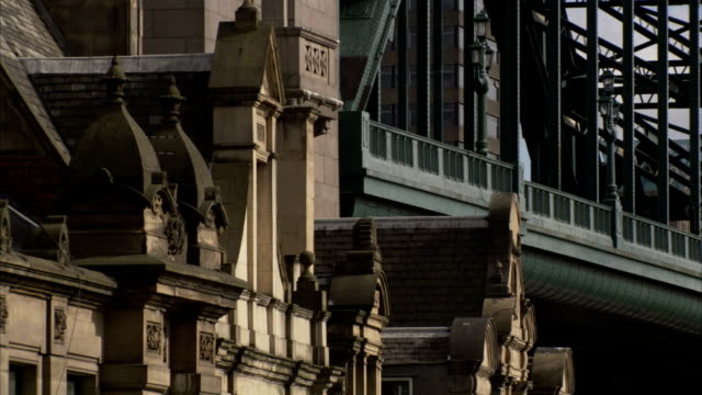 victorian buildings with the tyne bridge rising behind them in newcastle-upon-tyne. available in hd. - tyne bridge stock videos & royalty-free footage