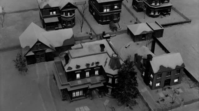 victorian homes appear cozy and inviting with lighted windows and smoke rising from chimneys. - 1946 stock videos & royalty-free footage