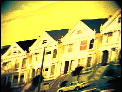 vídeos de stock e filmes b-roll de distorted victorian houses on steiner street / san francisco - super exposto