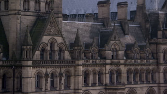 victorian spires top the manchester town hall in england. available in hd. - rathaus stock-videos und b-roll-filmmaterial