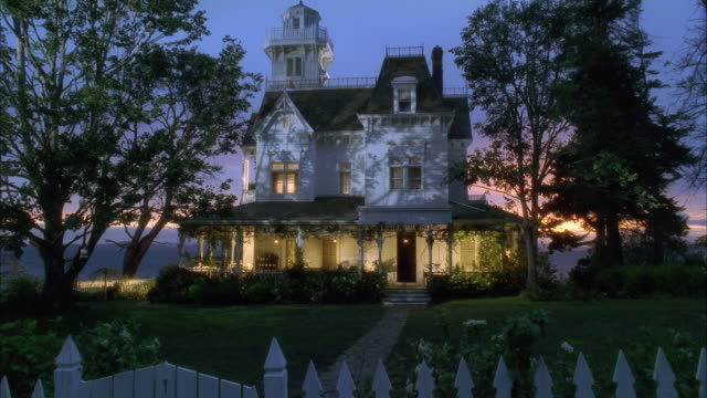 WS Victorian style house illuminated at dusk