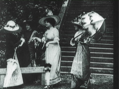 pan victorians dressed up in gowns with hats and parasols / united states - 19th century style stock videos and b-roll footage
