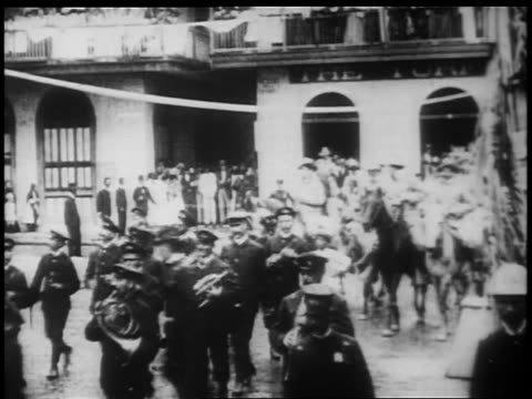 B/W 1898 victorious Rough Riders on horseback parading thru village street / SpanishAmerican war