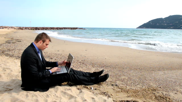 Victory businessman at the beach