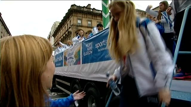 Victory parade for Scottish athletes EXT Erraid Davies down from victory parade float and interview SOT Marching pipe band along in voctory parade...