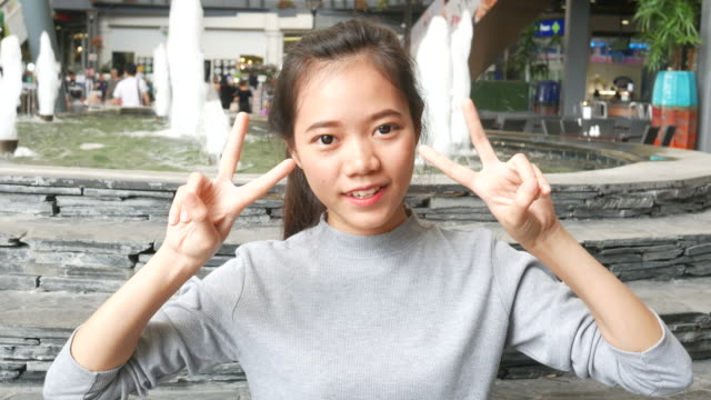 victory sign, hand gesture  by young woman - symbol stock videos & royalty-free footage