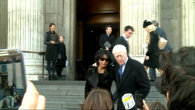 london ext actor sir michael caine and hsi wife shakira outside st paul's cathedral where they were attending a memorial service for the hairdresser... - shakira caine stock videos and b-roll footage