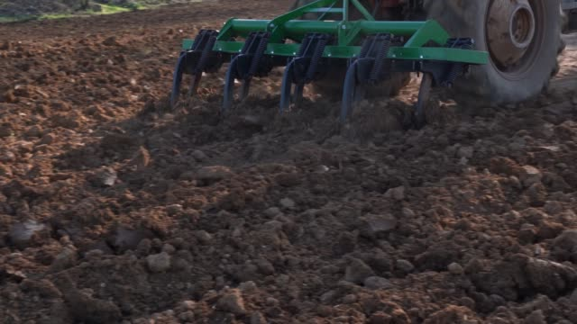 UHD Vide Of Tractor Harrowing Field