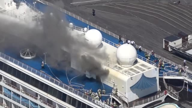 video taken from a kyodo news helicopter shows smoke rising from the upper deck of the asuka ii cruise ship docked in yokohama, near tokyo, on june... - moored stock videos & royalty-free footage