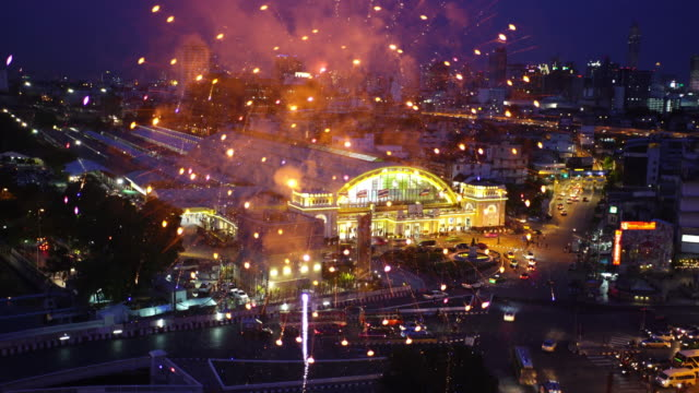 WS video 4k:Double exposure of the city and fireworks.