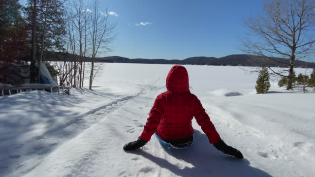 4k video pov of a woman sliding outdoors at wintertime - cold temperature stock videos & royalty-free footage