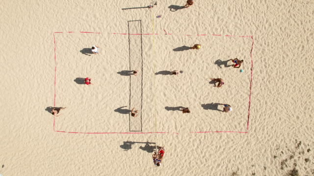 4k video aerial view beach volleyball - volleyball sport stock videos and b-roll footage