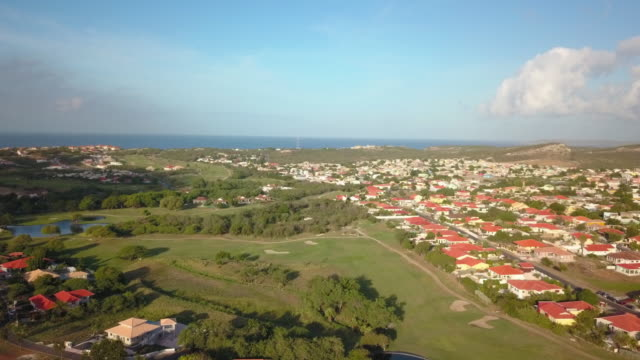 4K Video Aerial View of a Residential Area and Golf Course in Curacao