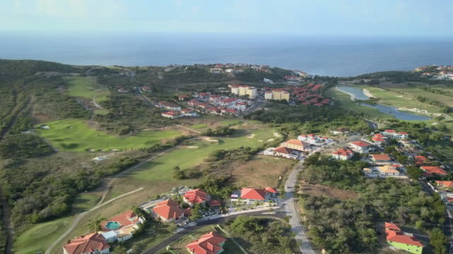 4k video aerial view of a residential area and golf course in curacao - caribbean sea stock videos & royalty-free footage