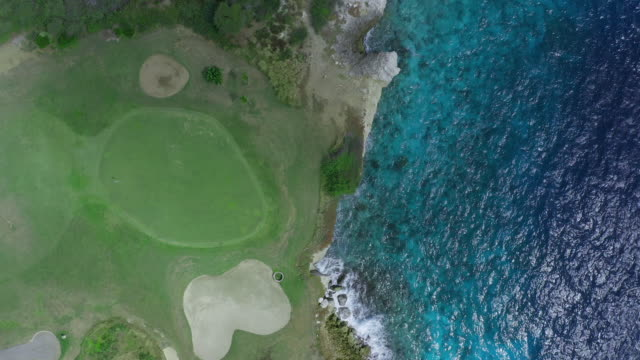4k video aerial view of caribbean sea and green - golf course - bay of water stock videos & royalty-free footage