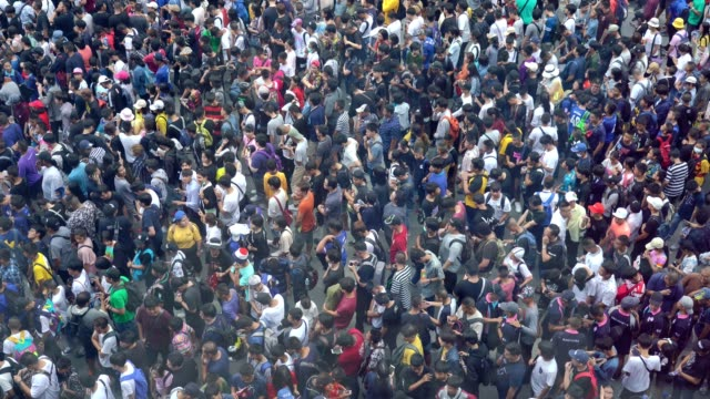 4k video: aerial view of crowded people. - crowd of people stock videos & royalty-free footage