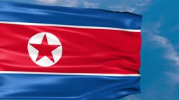 Video Animation of North Korea flag waving in the wind on blue sky background