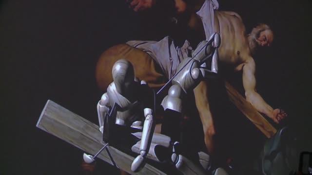 video artists recreate 57 of michelangelo merisi da caravaggio's artworks using high definition projectors that help bring the sixteenth century... - michelangelo artist stock videos & royalty-free footage