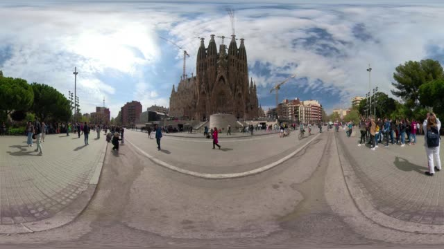 360 video Barcelona Sagrada Familia by Gaudi. Nativity facade. Main entrance of this basilica by Gaudi from the park. VR equirectangular panorama