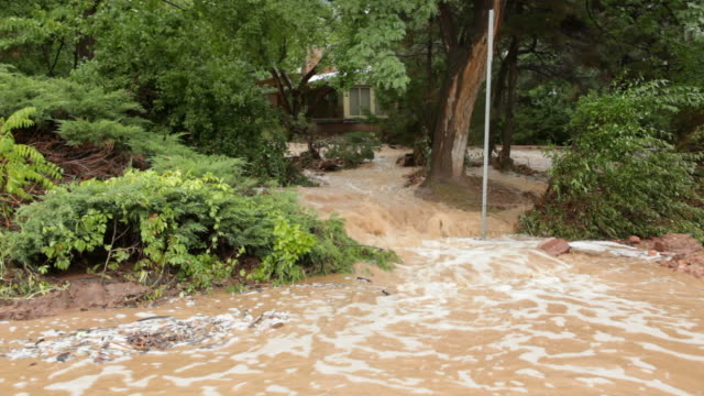 HD video Boulder flood waters cascades through homes