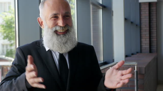 4k video - business. bearded businessman smiling cheerfully - 50 59 years video stock e b–roll