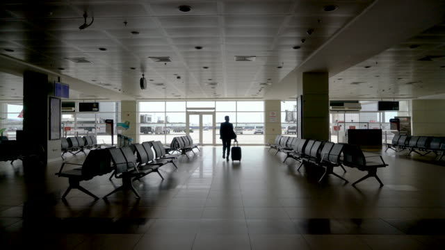 4k video, businessman walking to desk in airport - ozgurdonmaz stock videos and b-roll footage
