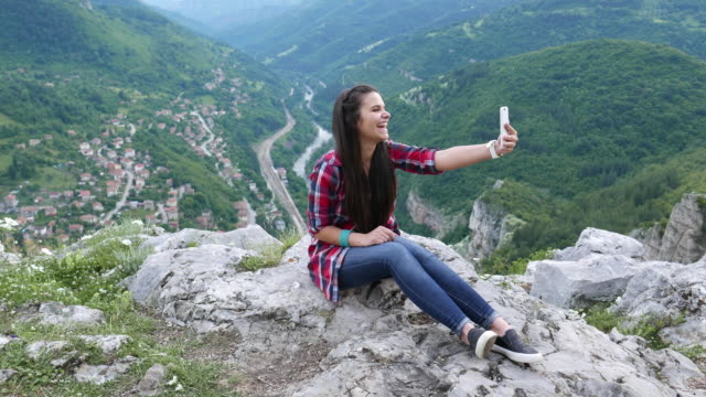 video call among nature - teenage girls stock videos & royalty-free footage