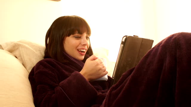 video call to family and friends in dressing gown (bed) - bathrobe stock videos and b-roll footage