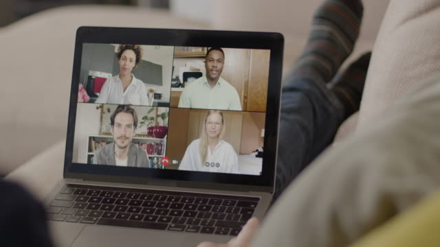 video call with colleagues working from home, business people using video conferencing technology for virtual meeting - employee engagement stock videos & royalty-free footage