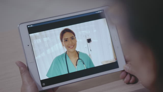 video call with doctors - civilian stock videos & royalty-free footage