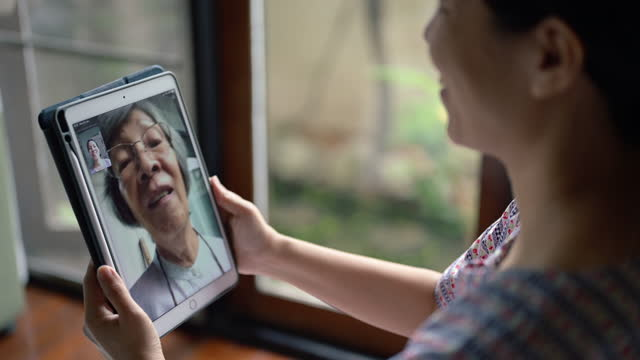 video call with family - chinese ethnicity stock videos & royalty-free footage