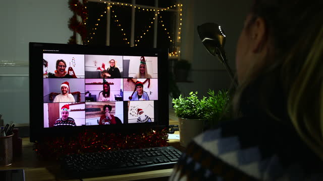 video calling my colleagues at christmas - tinsel stock videos & royalty-free footage