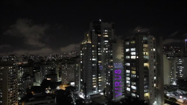 video capture projections from the project janelassso made by the artist fluxus las3r_ during a protest against brazil's president jair bolsonaro on... - cidade stock videos & royalty-free footage