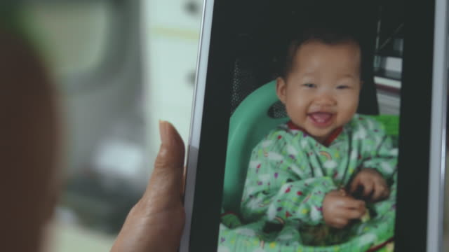 video chat : little baby eating at home - distant stock videos & royalty-free footage