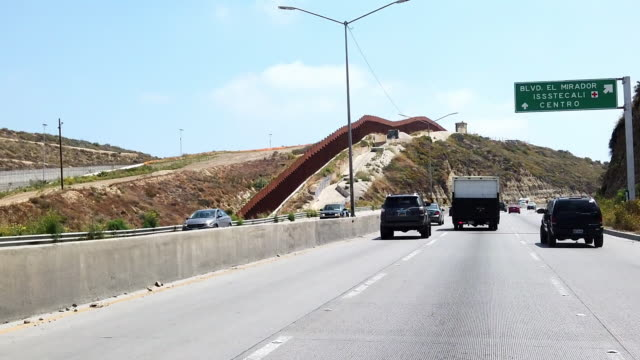 video clip near the international border wall from the freeway in playas tijuana, mexico - international border stock videos and b-roll footage