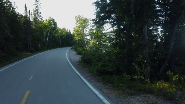 video clip of a beautiful bicycle ride around mackinac island, michigan - michigan stock videos & royalty-free footage