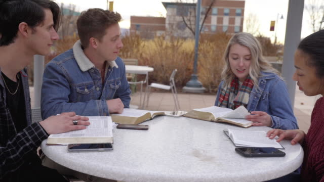 a video clip of a group of multiple race students having a discussion and studying the bible - church stock videos & royalty-free footage