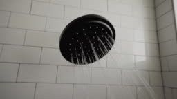 A Video Clip Of Drops Of Water Falling From A Shower Head