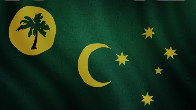 4-k video : cocos island waving flag - cocos or keeling islands australian territory stock videos and b-roll footage