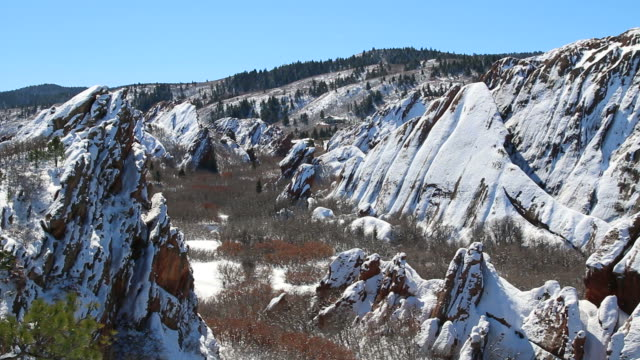hd video colorado winter hiker in snowy roxborough state park - state park stock videos & royalty-free footage