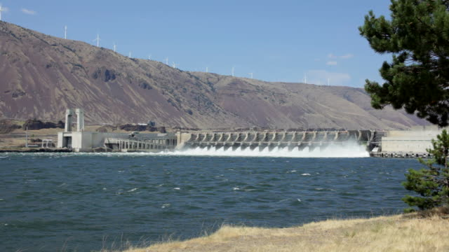 hd video columbia river dalles dam and wind farm washington - dam stock videos and b-roll footage