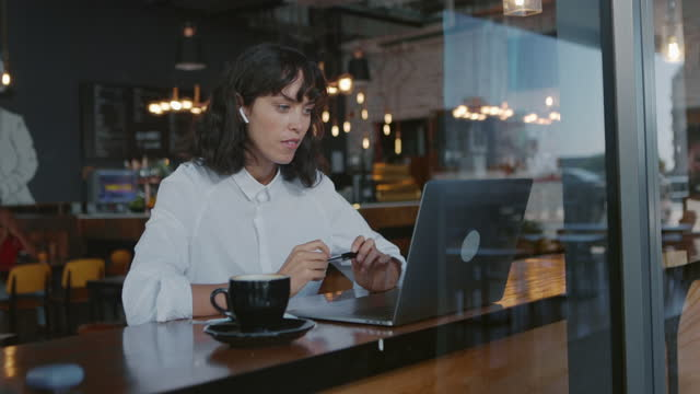 video conference in cafe - laptop stock videos & royalty-free footage