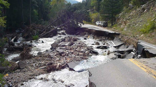 HD video Creek washes out road Boulder Colorado