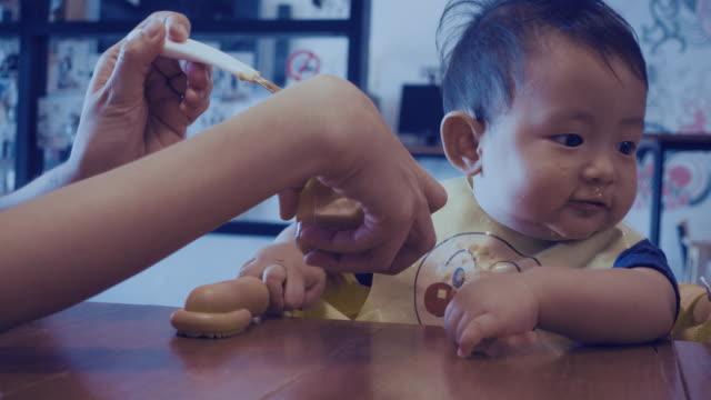 4K Video - Cute baby eating baby food