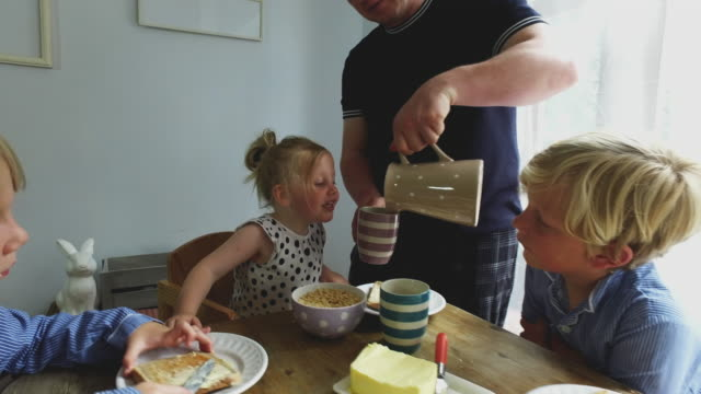 4k video - day in the life of a family - milk jug stock videos & royalty-free footage