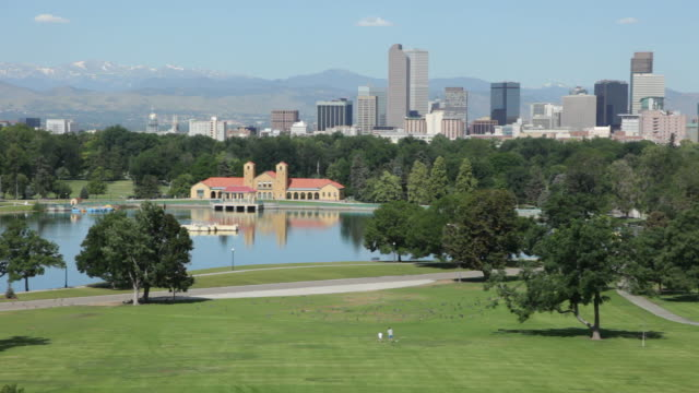 hd video denver's city park with skyline and mountains - denver stock videos and b-roll footage